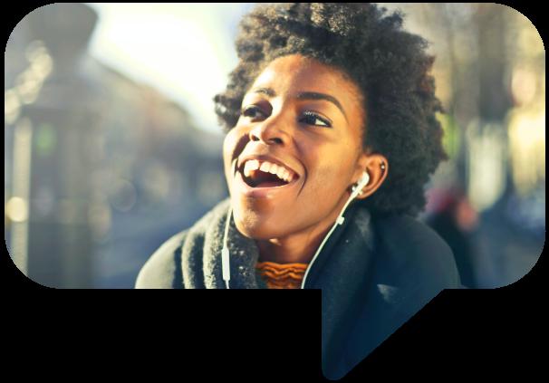 Woman smiling wearing headphones