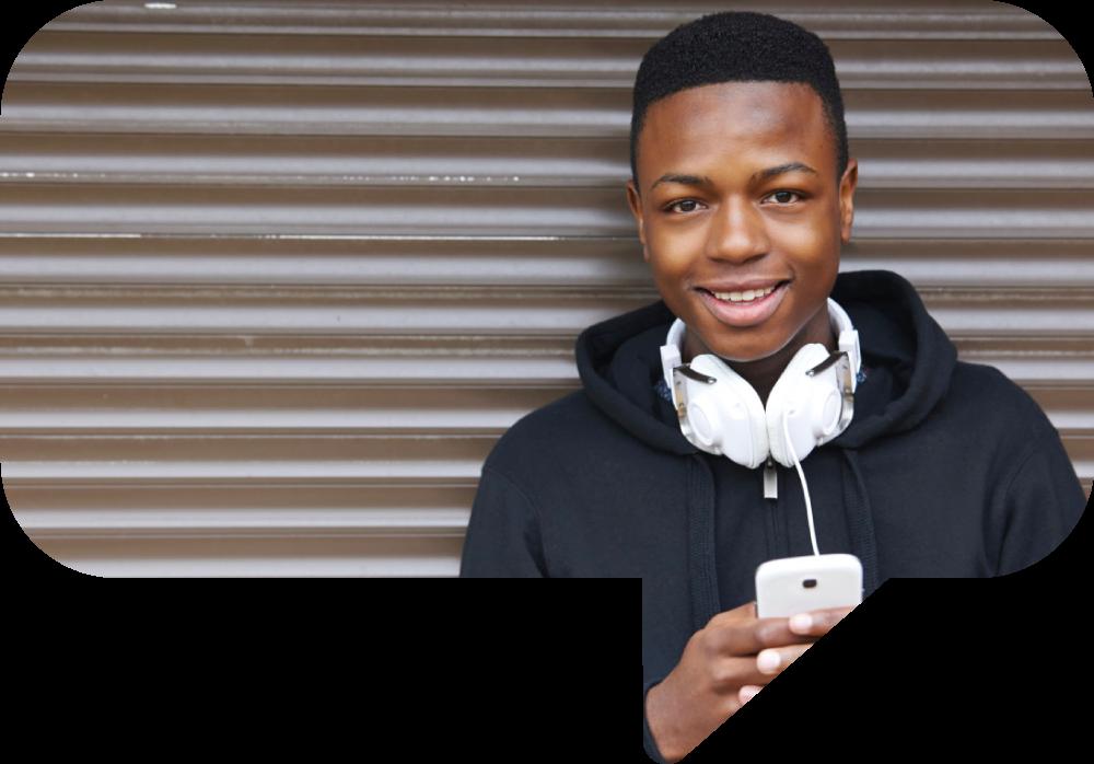 Teenage boy in hoody looking at camera